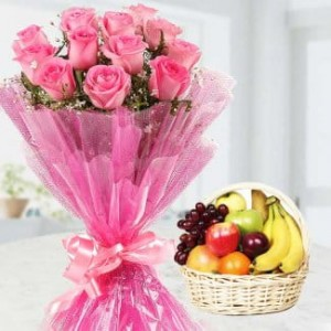 A bunch of 12 pink roses with nice basket of 3 kg fruits.