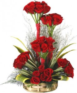 One sided tall arrangement of Red Roses.