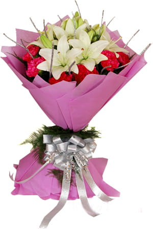 An elegant bunch of White Lilies and Red Carnations in pink wrapping, to mesmerize your loved ones.900.jpg