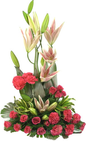 One sided arrangement of beautiful pink Oriental Lilies, Roses and Carnations with green leaves, to leave your loved ones spellbound.1500.jpg